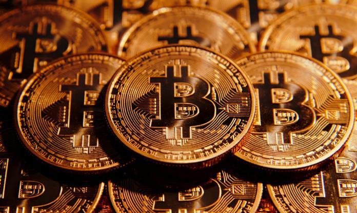 Bitcoin-696x415.jpg.6134492d080d621ab5ce1944f02ca4c2.jpg